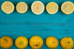 Fresh organic lemons and limes on wooden background Stock Image