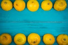 Fresh organic lemons on wooden background Stock Photo