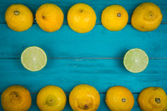 Fresh organic lemons on wooden background Stock Photos