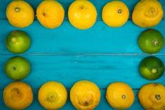 Fresh organic lemons on wooden background Royalty Free Stock Photo