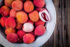 Fresh organic lychee fruit in a bowl on wooden background. Top view Stock Photography