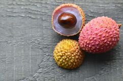 Fresh organic lychee fruits and on a rustic wooden background.Exotic tropical litchi berry.Lychees. Stock Images