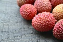 Fresh organic lychee fruits and on a rustic wooden background.Exotic tropical litchi berry.Lychees. Stock Photography