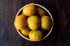 Fresh Organic Mandarin Oranges / Dark Moody Background. Organic Food Royalty Free Stock Images