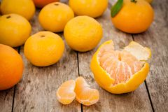 Fresh organic mandarins and peeled slices Royalty Free Stock Images