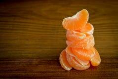 Fresh organic mandarins and peeled slices on a Stock Photo