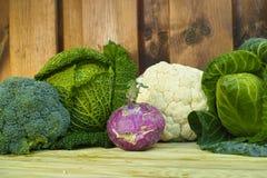 Fresh organic market vegetables on wooden background Stock Photo