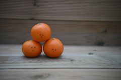 Healthy food photography image of fresh organic oranges with happy drawn on smile on rustic wood background with copy space. Fresh organic natural foodie fruit Royalty Free Stock Photos