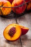 Fresh organic nectarines in a basket closeup Stock Photo