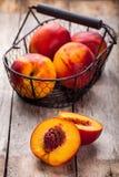 Fresh organic nectarines in a basket closeup Royalty Free Stock Photo