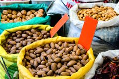 Fresh organic nuts for sale Royalty Free Stock Images