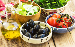 Fresh Organic Olives, Greens, Radish and Cherry Tomatoes in Bowl Royalty Free Stock Photography