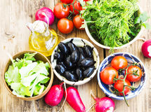 Fresh Organic Olives, Greens, Radish and Cherry Tomatoes in Bowl Royalty Free Stock Image