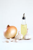 Fresh organic onion, garlics and olive oil Royalty Free Stock Images
