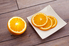 Fresh organic oranges fruits on wooden table. Royalty Free Stock Image