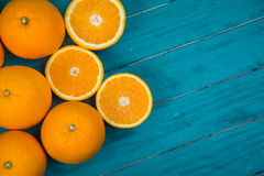 Fresh organic oranges halves  on wooden background Royalty Free Stock Image