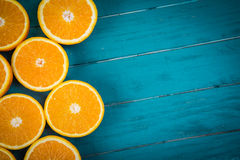 Fresh organic oranges halves  on wooden background Royalty Free Stock Photography