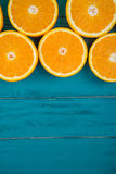 Fresh organic oranges on wooden background Stock Image