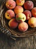 Fresh organic peaches in basket Royalty Free Stock Photos