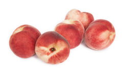 Fresh organic peaches. A group of fresh organic peaches. White background Royalty Free Stock Images