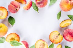 Fresh organic peaches, simple pattern. Layout on white background royalty free stock photo