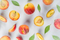 Fresh organic peaches, simple pattern. Layout on white background royalty free stock images