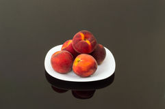 Fresh Organic Peaches in a White Plate. Fresh Organic Peaches Served in a White Plate Stock Image