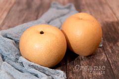 Fresh organic pear fruits on the wooden backgrounds with copy space Royalty Free Stock Photography
