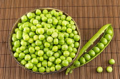 Fresh organic peas in a bowl. Ready for cooking Stock Photos