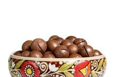 Fresh organic peeled macadamia nuts in ceramic bowl isolated on white stock photo