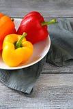 Fresh organic pepper on plate Stock Photo