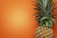 Fresh organic pineapple, Tropical Fruit. Fresh pineapple on a orange background Stock Photography