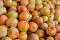 Fresh organic plums on street market stall Royalty Free Stock Image