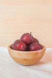 Fresh organic plums in a wooden bowl. Selective focus Royalty Free Stock Images