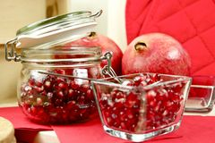 Fresh Organic Pomegranate. Fruit in Glass Containers Royalty Free Stock Photo
