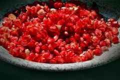 Fresh organic pomegranate in marble bowl Royalty Free Stock Photography