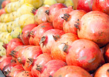 Fresh organic pomegranate for sale at a market Stock Images