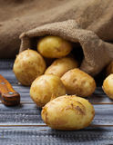 Fresh organic potatoes in wooden table Stock Image