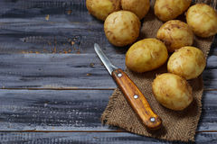 Fresh organic potatoes in wooden table Royalty Free Stock Photo