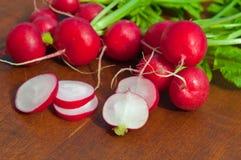 Fresh organic radish. Fresh ripe organic radish on wood table Royalty Free Stock Photography