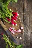 Fresh organic radish on cutting board Royalty Free Stock Photography