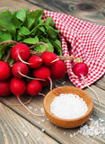 Fresh organic radish. On a old wooden background Stock Photos
