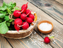 Fresh organic radish. On a old wooden background Stock Images