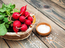 Fresh organic radish. On a old wooden background Royalty Free Stock Image