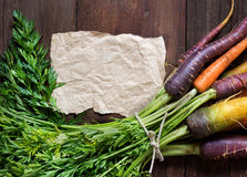Fresh organic rainbow carrots and paper Stock Photo