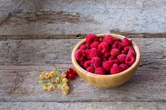 Fresh organic raspberries on bowl wood background. Royalty Free Stock Photos