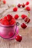 Fresh   organic raspberries and cherries Royalty Free Stock Photos