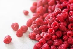 Fresh organic raspberries. Fruit background with copy space. Summer and berries harvest concept. Vegan, vegetarian, raw. Food Royalty Free Stock Photos