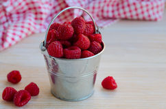 Fresh organic raspberries. In metal bucket on wooden background. Healthy eating and vegan concept. Copy space Royalty Free Stock Photos