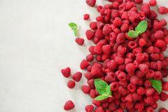 Fresh organic raspberries with mint leaves. Fruit background with copy space. Summer and berries harvest concept. Vegan. Vegetarian, raw food Royalty Free Stock Photography